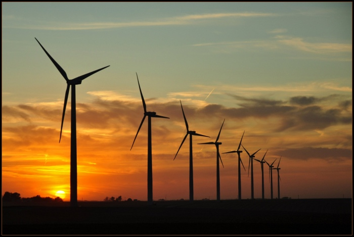 Wind turbines at dusk near Colo, Iowa. (TumblingRun / Flickr)