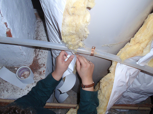 Wrapping a water heater can save energy and money. Photo by CERTs, Flickr.