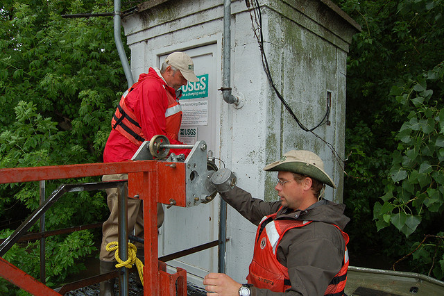 USGS employees checking a streamgage. Photo by U.S. Geological survey; Flickr.