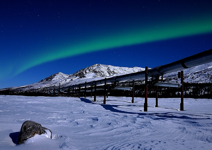 An oil pipeline in Alaska. Photo by Sebastian Saarloos; flickr
