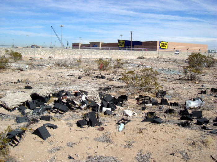 Old car batteries and other debris strewn across an empty lot in El Paso, Texas. (Paul Garland/Flickr)