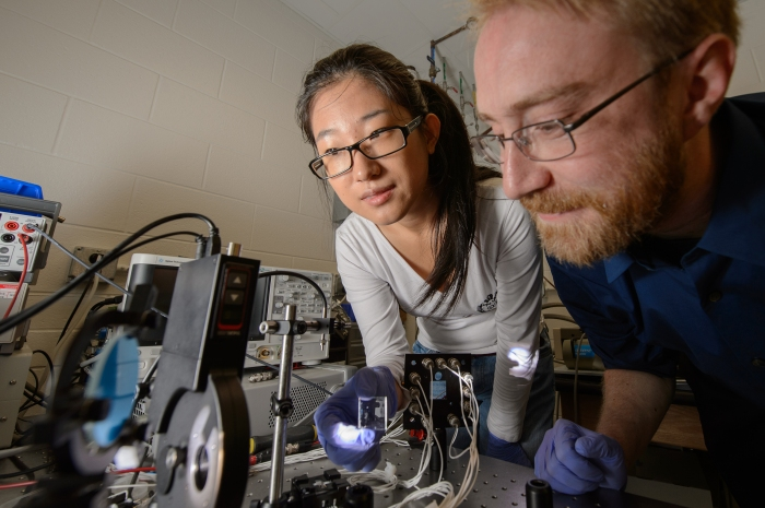 Yimu Zhao, a doctoral student in chemical engineering and materials science, and Richard Lunt, assistant professor of chemical engineering and materials science, work together in a lab. (Photo by G.L. Kohuth)