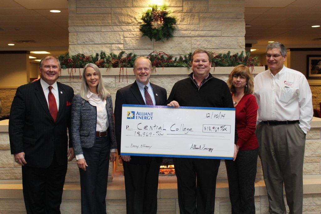 Earlier this month Central College was presented with a check from Alliant Energy. From left: Bill Northup, vice president for advancement; Peggy Fitch, vice president of student development, Mark Putnam, Central College president; David Vollmar, Alliant Energy key account manager; Janine Fontana, operations manager and Mike Lubberden, Central College director of facilities planning and management. (Central College News)