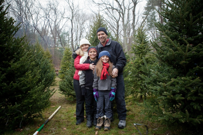 A family at a Christmas tree farm (Mass Office of Travel / Flickr)