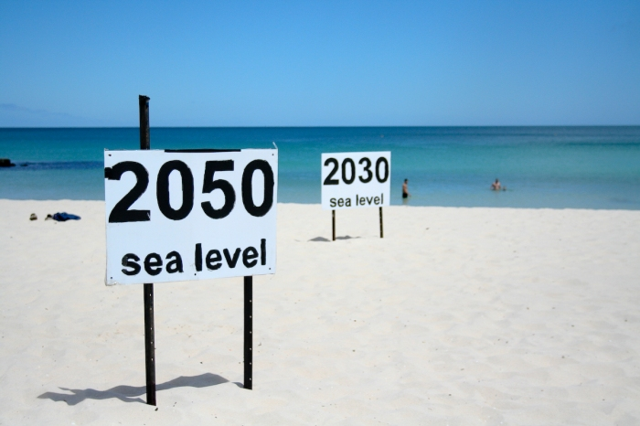 These signs indicate how the coast line is expected to move inward at Cottesloe Beach in Perth, Australia. (go_greener_oz/Flickr)