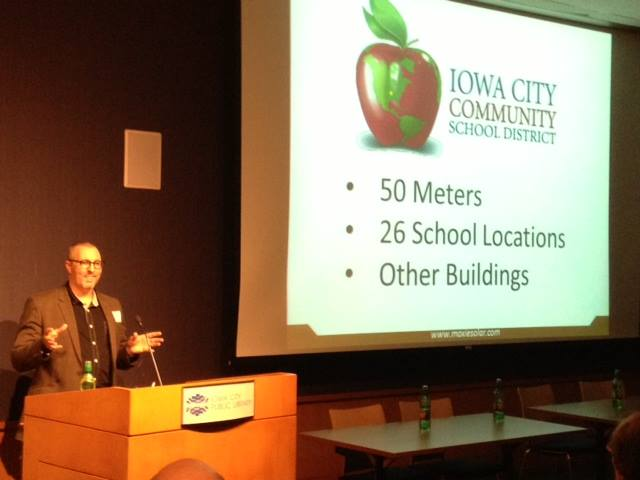 Troy Miller - Director of Power Purchase Agreements for Moxie Solar - discussed a recent collaboration between Moxie and the Iowa City Community School District during the Ecopolis Iowa City forum on January 21. (Photo by Jeff Biggers)