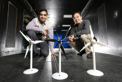 Iowa State University aerospace engineers Anupam Sharma (left) and Hui Hu stand behind 3D models of turbine prototypes. (Christopher Gannon/Iowa State University News Service)