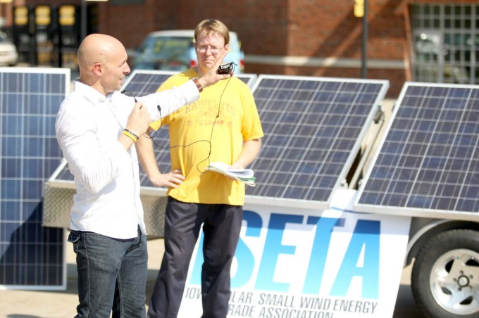 Tim Dwight (left) with Iowa state Sen. Rob Hogg (D-Cedar Rapids) during a proposal to install solar panels on Kinnick Stadium in 2012. (Tessa Hursh/The Daily Iowan archives)