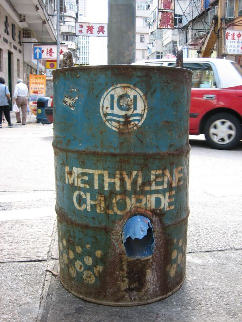 A barrel once containing methylene chloride now serves as the base for a street light in Hong Kong. (Georgia/Flickr)