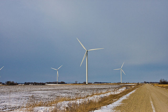 Wind turbines on a snowy Iowa field. (Tony Webster/Wikimedia Commons)