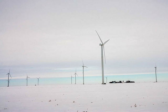 Wind turbines on a snow covered field in Iowa. (Michael Leland/Flickr)