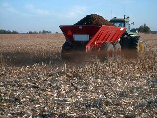 Dry poultry manure being applied to an Iowa farm field. (Angela Rieck-Hinz/Iowa State University Extension)