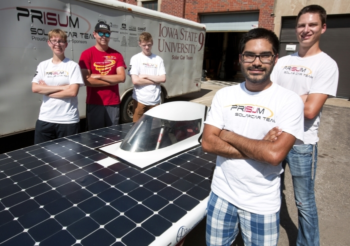 Members of Team PrISUm -- from left, Charlotte Brandenburg, Garret Coleman, Philip Gates, Arun Sondhi and Matt Goode -- are preparing their solar racing car for this summer's two races. Larger photo. (Christopher Gannon/Iowa State University News Service)