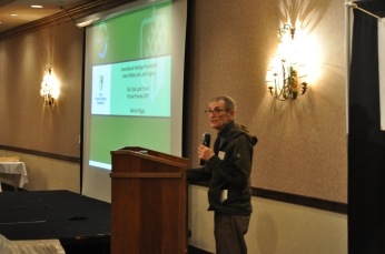 Dick Schwab, long-time Iowa conservationist, introduces the keynote speaker, Dr. Hendrix. (Jenna Ladd/CGRER)