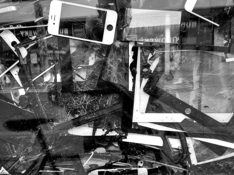 Pile of discarded smartphone and tablet screens.
